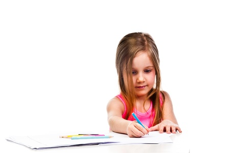 Small and beautiful girl draws pencil photo