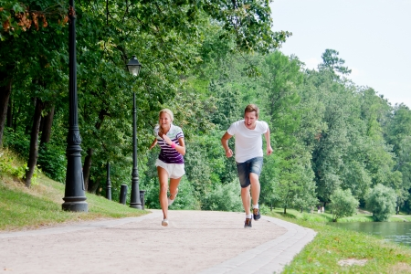 a man and a woman running in the park race photo