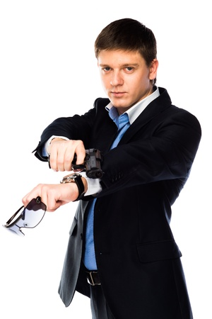 young and handsome man with a gun in his hand Stock Photo - 18566616