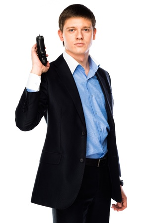 young and handsome man with a gun in his hand Stock Photo - 18566654