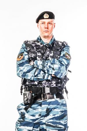 detective agency: police special squad officer in full ammunition Stock Photo