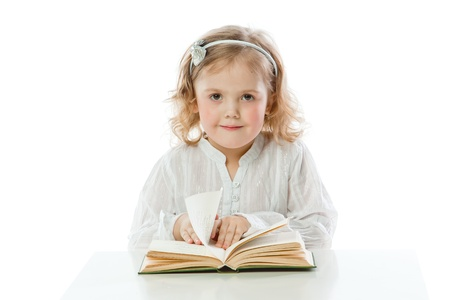 Small and beautiful girl reading a book Stock Photo
