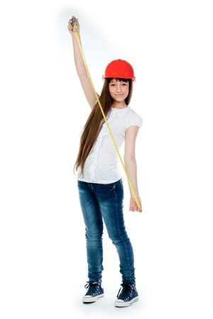 beautiful girl in a building helmet and tools in hand photo