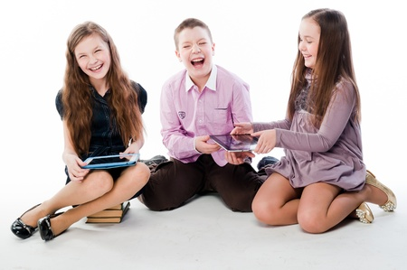 group of children with tablet computers photo