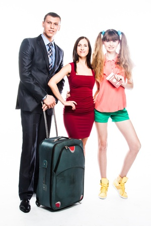 young and beautiful people with a suitcase going on a journey photo