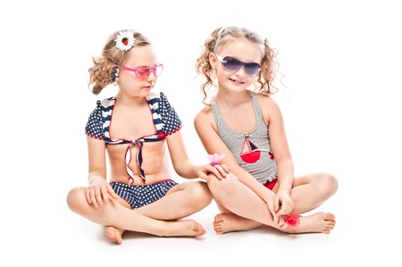 Two young and beautiful girls in bathing suits photo