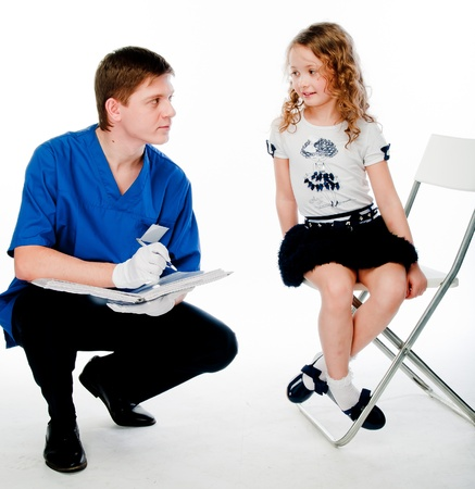 child to the doctor in blue robe photo