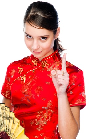 young and beautiful woman in a red Chinese dress photo