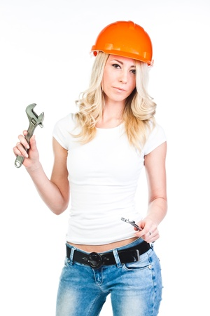 young beautiful woman in yellow construction helmet  photo