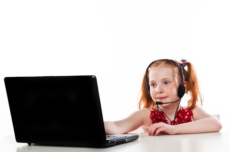 beautiful girl with a laptop and headset photo