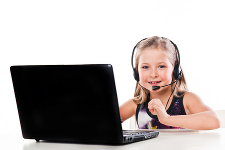 beautiful girl with a laptop and headset Stock Photo - 22238901