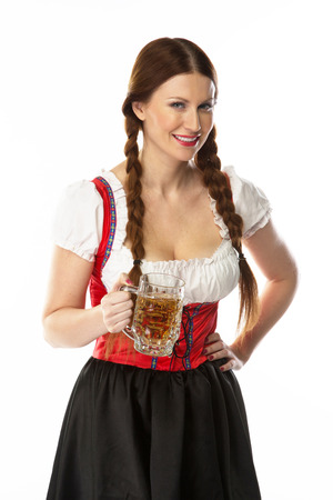 young and beautiful woman in a traditional Bavarian dress Stock Photo - 22993905