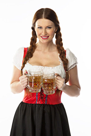 young and beautiful woman in a traditional Bavarian dress Stock Photo - 22993912