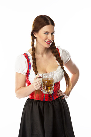 young and beautiful woman in a traditional Bavarian dress Stock Photo - 22993919