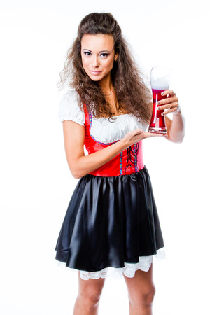 young and beautiful woman in a traditional Bavarian dress Stock Photo - 22993922