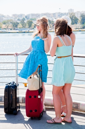 young and beautiful woman with suitcases photo