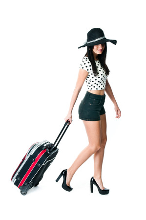 young and beautiful woman with a suitcase photo