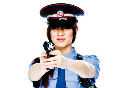 police woman: young and beautiful woman in police uniform