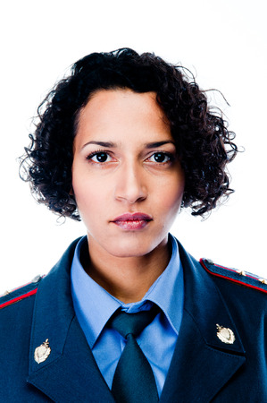 young and beautiful woman in police uniform photo
