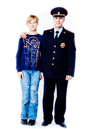 son in law: boy stands next to the police