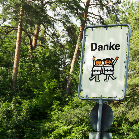 carefully: Thank carefully road sign children in German