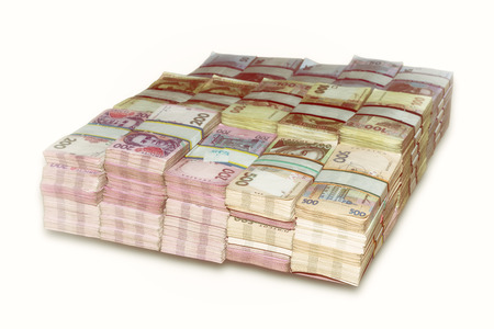 money stack: Ukrainian packs a lot of money the stacked Stock Photo