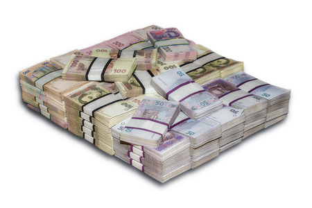 economic rent: Ukrainian packs a lot of money the stacked Stock Photo