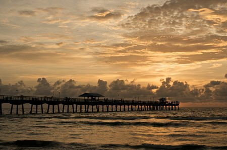 sunshine state: Sunrise in Lauderdale by the Sea Fishing Pier, in Fort Lauderdale, Florida.