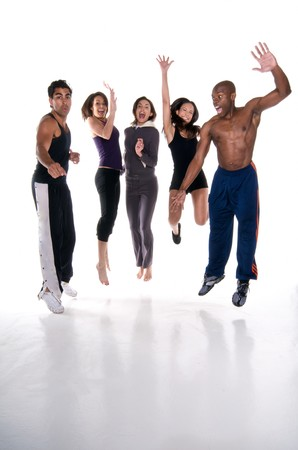 Group of multiracial young adults jumping with joy in fitness wear. All logos removed. Stock Photo