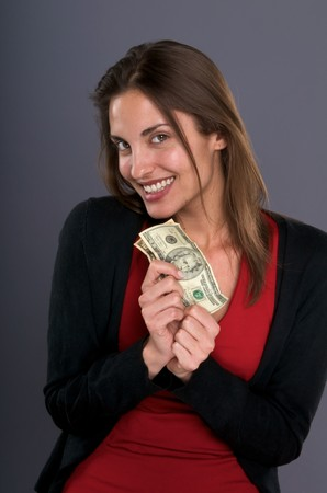 Young caucasian woman looking happy with dollar bills. No make up. photo
