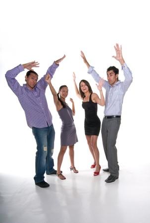 actitud positiva: Multirracial grupo de adultos j�venes de recaudaci�n de las manos con actitud positiva.