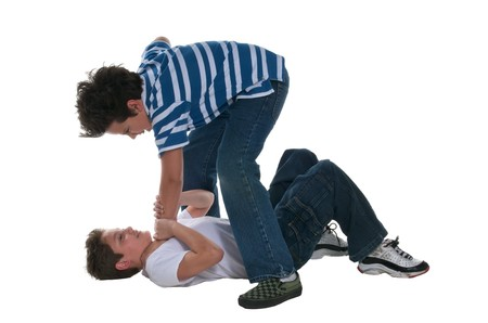 10s: Teens playing hard in the floor. Stock Photo