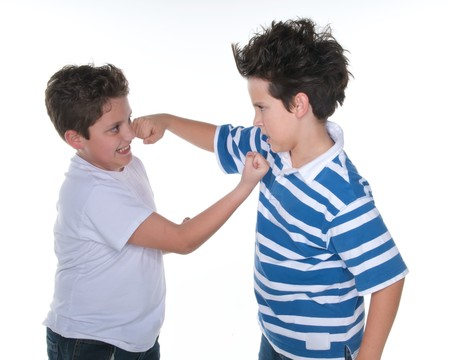 Boys fighting over white background