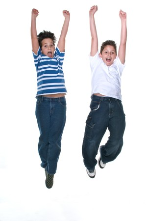 10s: Teens Jumping high very happy in white background. Stock Photo