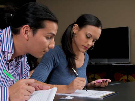 Young adults taking notes during a training session. Stock Photo - 4193288
