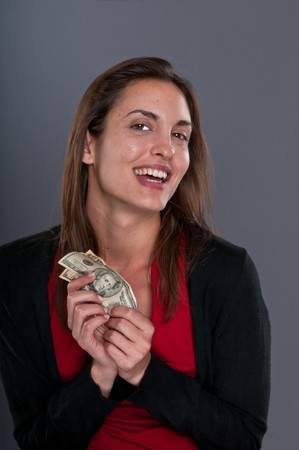Young Caucasian woman happy after receiving some money photo