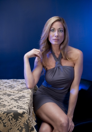 sexy mature women: Adult caucasian woman waiting for her friends or couple to arrive at night club or restaurant.
