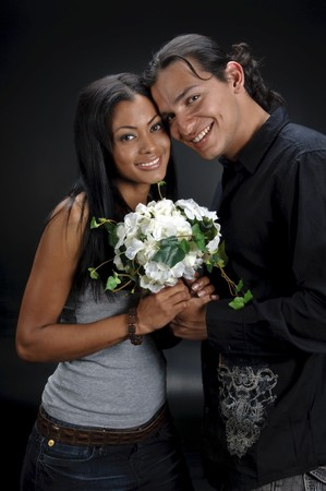 Young couple of hispanics people with black background. Stock Photo - 4341449