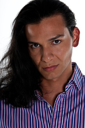 Portraitt of young lating man with long hair. 版權商用圖片