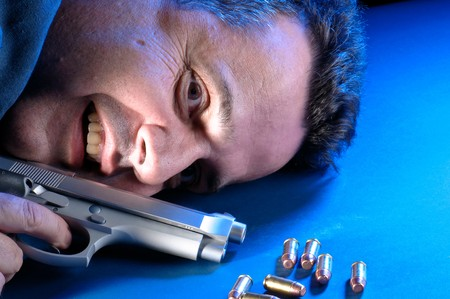 Forty something man desperate and lunatic about to comit suicide. Stock Photo - 4408036