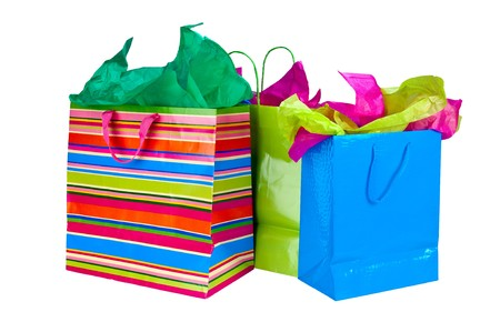 gift bag: Close up of shopping bags with colorful tissue paper. Stock Photo