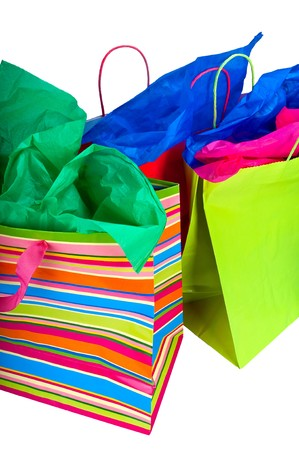 gift spending: Close up of shopping bags with colorful tissue paper. Stock Photo