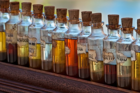 aromatherapy oils: Antique bottles of essentil fragances and oils lined up. fragances and oils lined up.