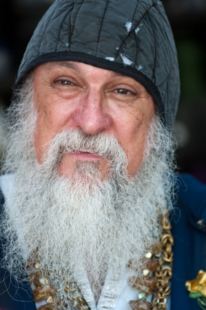 long: Portrait of old man with long beard smiling.