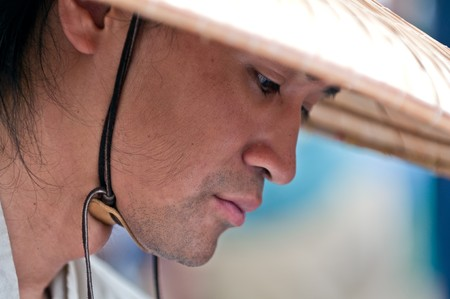 conical hat: Portrait of young oriental man pensive