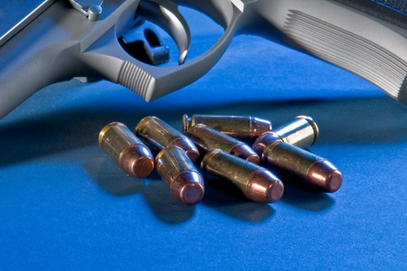 45 caliber: Close up view of bullets and gun. Use of selective focus. Stock Photo