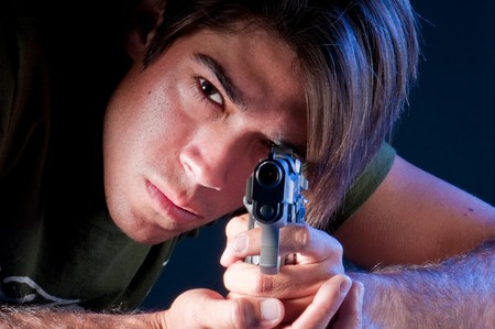 Young guy pointing with an automatic gun. Stock Photo - 4536687