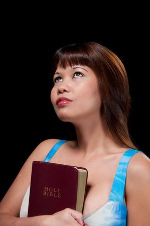 philippine adult: Young oriental woman holding faithful the Holy Bible.