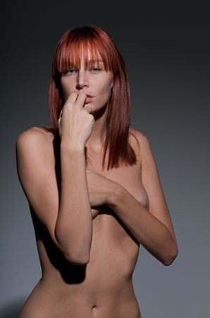 Young caucasian redhair posing nude with very suggestive attitude. Stock Photo - 4542274