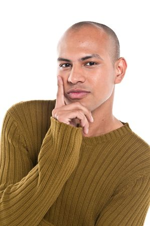Young man looking at camera thinking, isolated. Stock Photo - 4542305